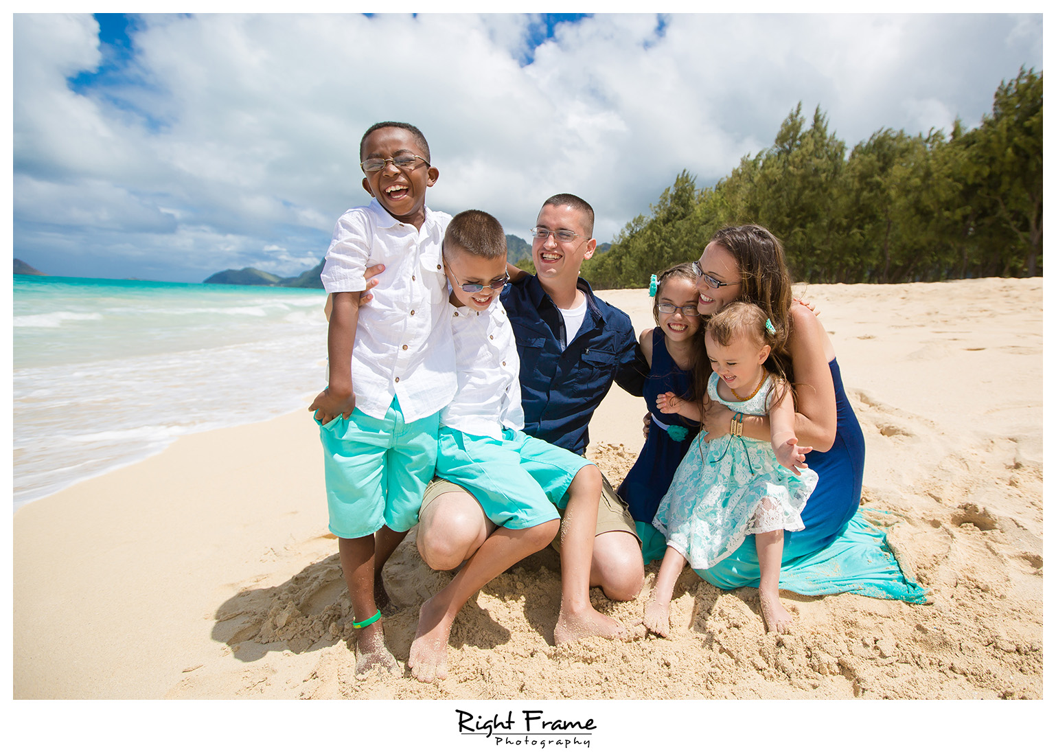 Family Having Fun at Waimanalo Beach Hawaii