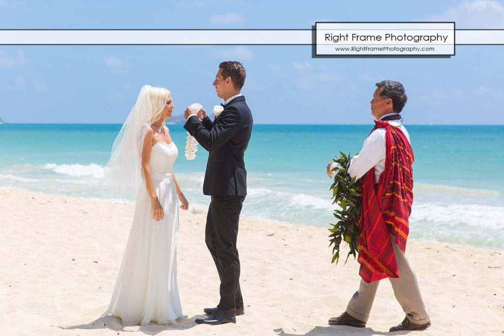 Small and Intimate Oahu Wedding at Waimanalo Bay Sherwood Forest Hawaii lei exchange