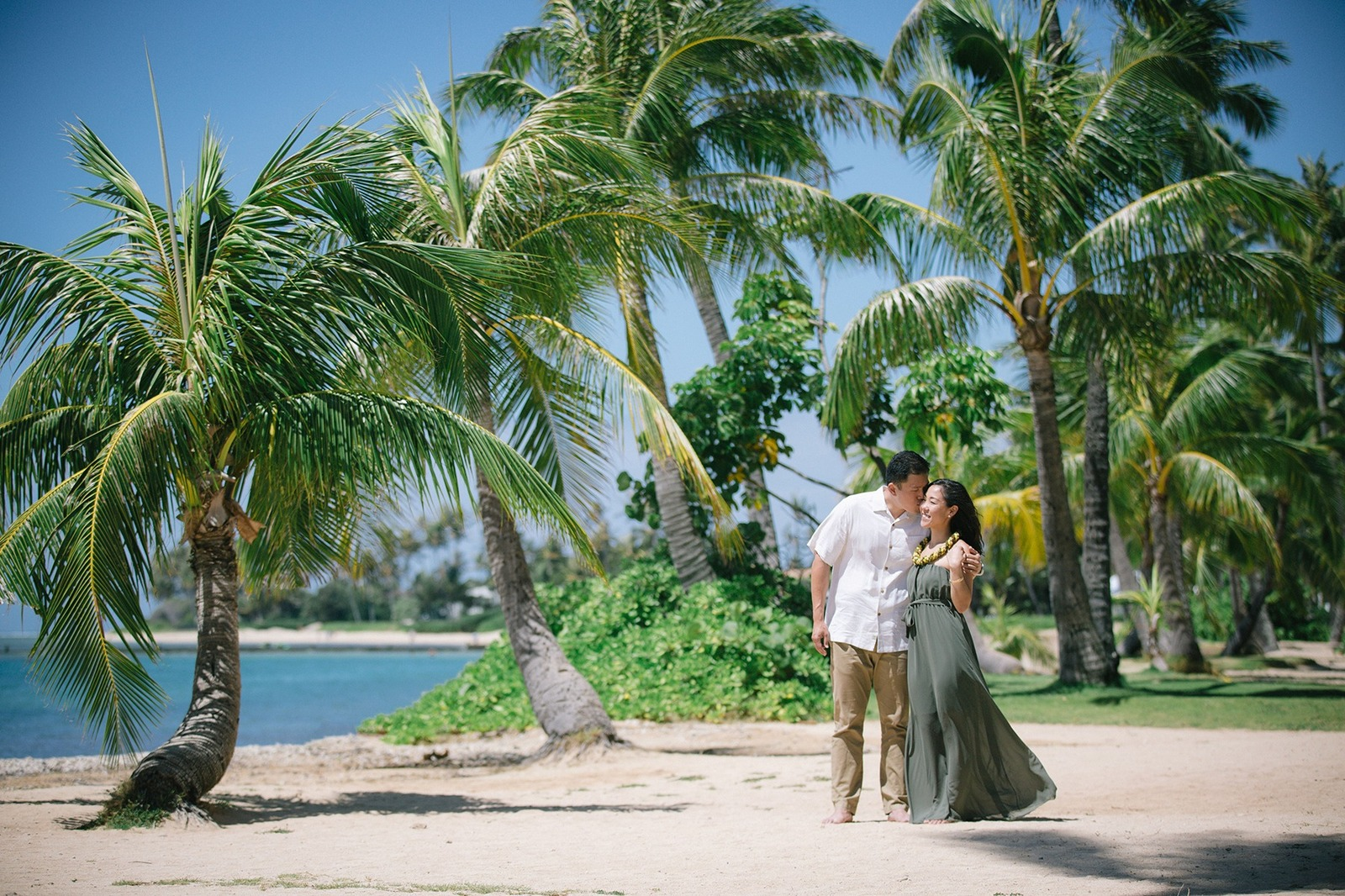 Oahu Engagement Photographer Tropical Kahala Beach Green Dress Palm Tress